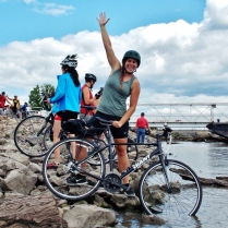 Halley dipping her front tire in the Mississippi River, Fort Madison, IA, RAGBRAI 2013